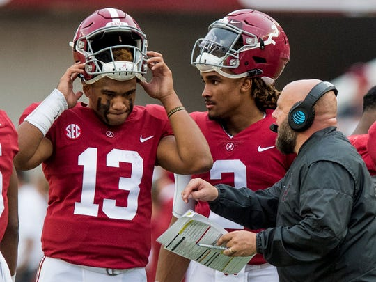 Alabama quarterback Tua Tagovailoa (13) and quarterback Jalen Hurts (2) talk with offensive coordinator Brian Daboll in second half action at Bryant-Denny Stadium in Tuscaloosa, Ala. on Saturday October 21, 2017. (Mickey Welsh / Montgomery Advertiser)