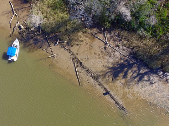 This aerial photo taken Tuesday, Jan. 2, 2018, in Mobile County, Ala., shows the remains of a ship that could be the Clotilda, the last slave ship documented to have delivered captive Africans to the United States. The Clotilda was burned after docking in Mobile, Ala., in 1860, long after the importation of humans was banned, and experts say the remains found by a reporter from Al.com could be what is left of the long-lost wreck.