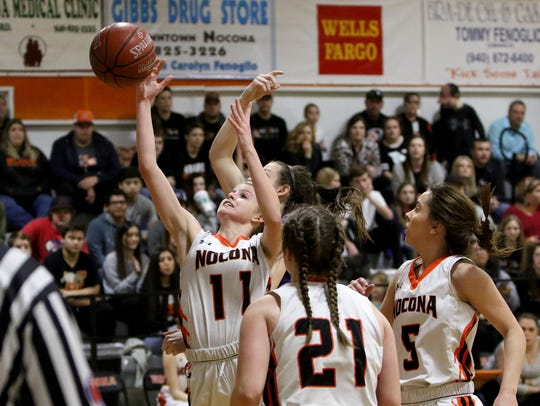 Nocona's Chloe Daughtry goes for the rebound in the