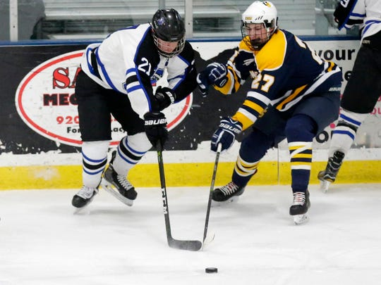 St Mary's Springs' Dawson Sarauer and University School of Milwaukee's Kylar Fenton battle for the puck Saturday during a Division 4 sectional final game at the Blue Line Family Ice Center in Fond du Lac.