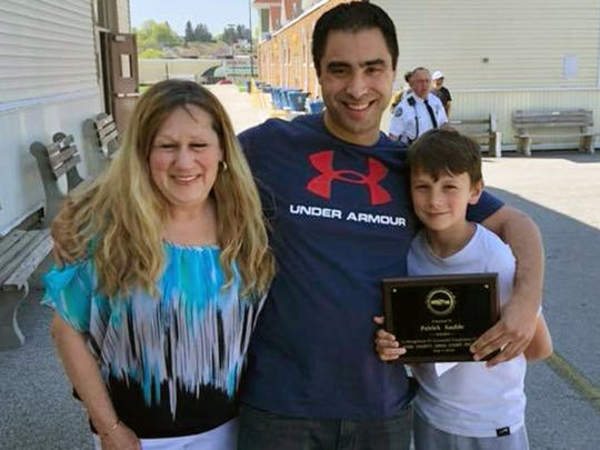 """In this photo, Pat Sauble, middle, poses with Kathy Sorandes, his fiancée's mother, and her grandson, CJ. The plaque commemorates Sauble's completion of York County Heroin/Opioid Wellness Court. It reads, """"Presented To Patrick Sauble. In Recognition Of Successful Completion of The York County Drug Court Program. May 1, 2018."""""""