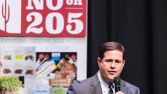Arizona Governor Doug Doucey addresses an anti-205