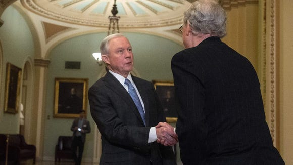 Sen. Jeff Sessions shakes hands with Senate Majority Leader Mitch McConnell following a meeting at the Capitol on Nov. 30, 2016.