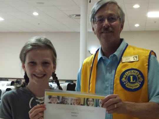 Neenah Lions Club secretary, Dale Counihan, right, presents Ruby Brown for her help collecting used eyeglasses for the Lions Club.