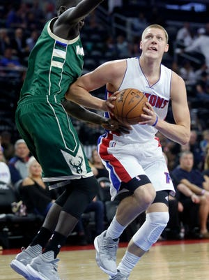 Pistons forward Henry Ellenson drives to the basket against the Bucks' Thon Maker during a preseason game Oct. 17 in Auburn Hills.