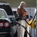 Falling gas prices have put more money into Americans' pockets, but the cash is largely staying there.