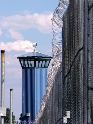 In this Aug. 31, 2007, file photo, a guard tower is seen behind the wire fence that surrounds California State Prison, Sacramento, in Folsom, Calif.