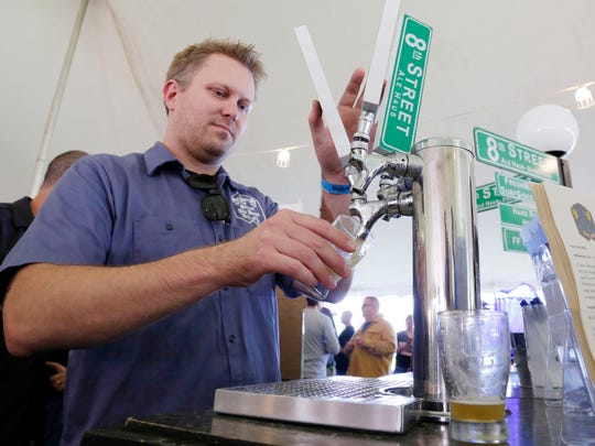 8th Street's Ale Haus' Eric Hansen of Sheboygan pours a beer Saturday September 24, 2016 at the Blue Harbor Craft Beer Festival in Sheboygan.