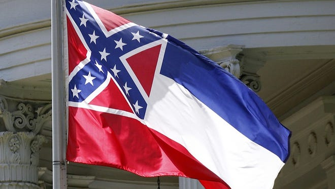 The state flag is unfurled against the front of the Governor's Mansion in Jackson.