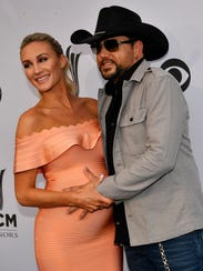 Country singer Jason Aldean and his wife, Brittany, arrive Aug. 23, 2017, at the 11th annual Academy of Country Music Honors awards in Nashville