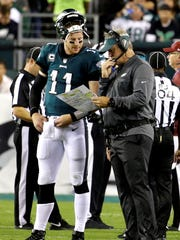 Philadelphia Eagles quarterback Carson Wentz (11) talks to head coach Doug Pederson during the first half of an NFL football game against the Washington Redskins, Monday, Oct. 23, 2017, in Philadelphia. Wentz and Pederson have proven to be a winning combination thus far.