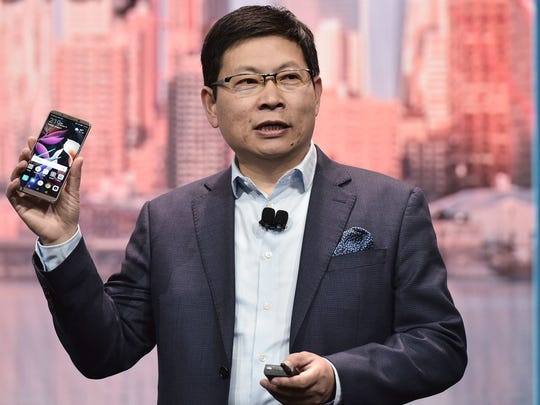 Richard Yu, CEO of Huawei's consumer business group, talks up the Mate 10 Pro phone during a keynote address during CES 2018 in Las Vegas on Jan. 9, 2018.