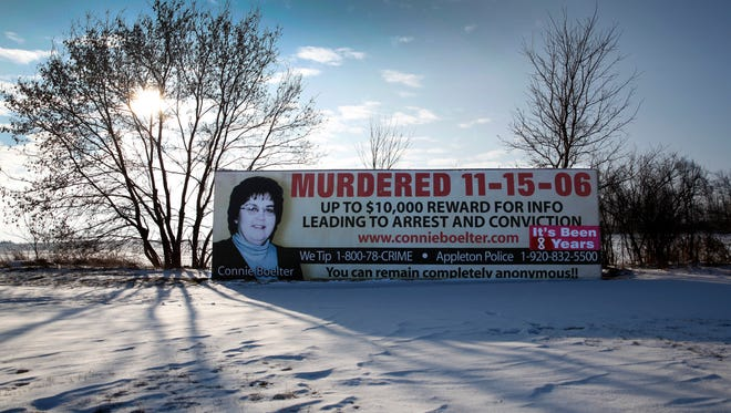 A large billboard for Connie Boelter stands along State 15 in Hortonville. Boelter was killed Nov. 15, 2006, and her killer has not been found.