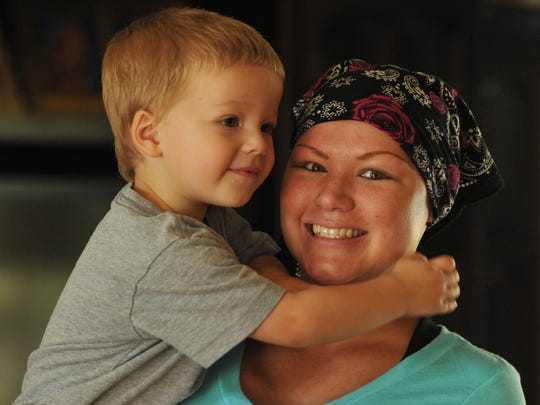 Give a Little Hope is a Brevard group founded by Randy Wouters that  is dedicated to helping cancer victims and  their families find hope. Photo shows cancer patient DeAnna Chase, 29, with her son, Camden Raymond, age two.