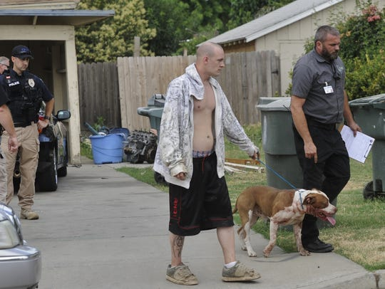 A pit bull broke through a fence, killing a neighboring