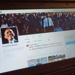 An illustration shows President Obama's Twitter page on a laptop in Washington, D.C.