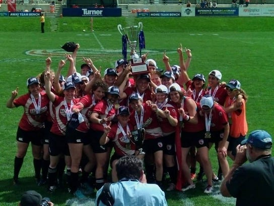 The Wisconsin Women's Rugby team celebrates after winning