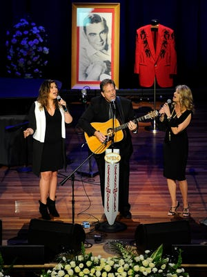 Hillary Scott, Lang Scott and Linda Davis perform at the funeral service for Grand Ole Opry member Jim Ed Brown at the Ryman Auditorium Monday June 15, 2015, in Nashville, Tenn.