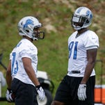 Detroit Lions wide receivers Calvin Johnson, right, and Golden Tate take part in a training session at Pennyhill Park Hotel in Bagshot, England, on Thursday, Oct. 23, 2014.