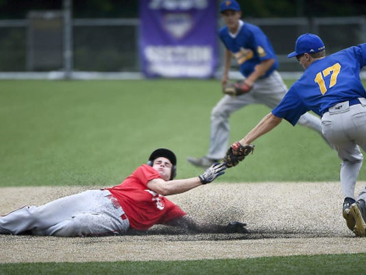Myerstown Kyle Knight is tagged out by Pleasureville shortstop Adam Reed while trying to steal second in the third inning.