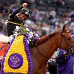Jockey Mike Smith celebrates after riding Judy the Beauty to victory in the Breeders' Cup Filly & Mare Sprint horse race at Santa Anita Park, Saturday, Nov. 1, 2014, in Arcadia, Calif.