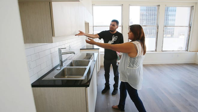 Joe Pineda and Marie Gomez examined the kitchen cabinets in a two-bedroom apartment at the Martin Lofts, 217 N. Stanton, during a public open house Thursday.