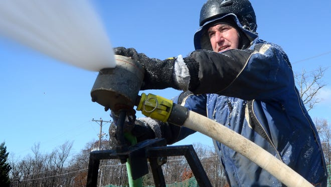In this file photo, Roundtop Mountain Resort employee Jon Sprenkle points a snow-making nozzle at the ski area Tuesday, Nov. 18, 2014. (Bill Kalina - bkalina@yorkdispatch.com)