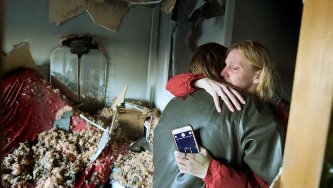 Austin Kling, 21, hugs his mother Sally while surveying the damage to his apartment where he lived with his girlfriend Wednesday, Jan. 6, 2016. An early morning blaze in the complex in the 300 block of Queensdale Dr. displaced about 30 residents. Kling said the Red Cross has provided a hotel for him and his girlfriend.