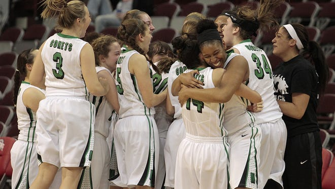 The Mason Comets celebrate their win and advancement to the state finals.  Mason knocks out Solon in the Division I State Semi-final match 48-31 at Value City Arena at the Schottenstein Center at Ohio State Friday, March 11th, 2016.
