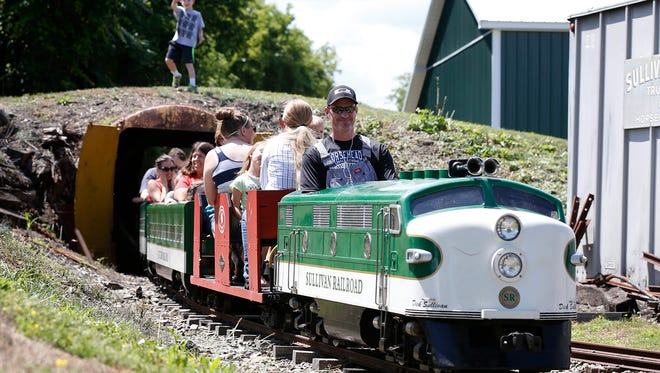 "Conductor Kevin Sullivan steers a 15"" gauge train at Sullivan Railroad in Horseheads with giddy children - and adults - in tow."