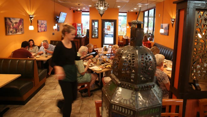 The Olive Tree Cafe's dining room features Moroccan decor.