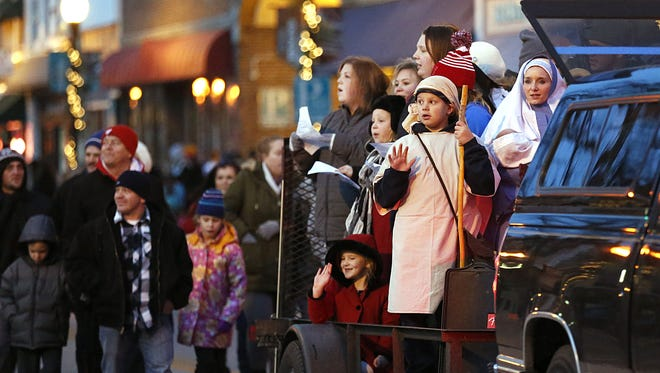 Mild and dry weather helped to bring out thousands of people in Fond du Lac Saturday night, to watch the 2015, Christmas Parade of Lights