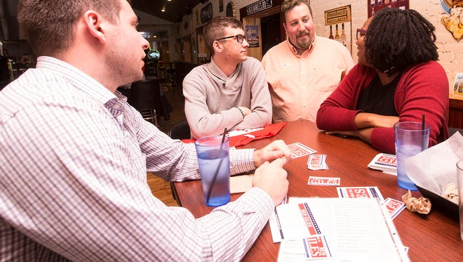 Ben Giles, (second from right) celebrates his Fond du Lac City Council election Tuesday, April 3, 2018 at Ziggys Pub in Fond du Lac with friends Zach Wagner, Alex Tryon, and Shavana Talbert. Doug Raflik/USA TODAY NETWORK-Wisconsin
