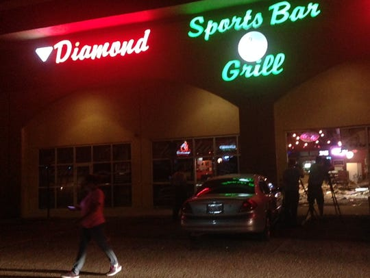People and officers mill about Diamond Billiards after