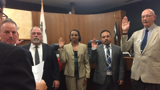 Oxnard elected officials are sworn in during the City Council meeting on Tuesday. From right are Treasurer Phillip Molina, Councilman Oscar Madrigal, City Clerk Michelle Ascencion, Councilman Bryan MacDonald and Mayor Tim Flynn.