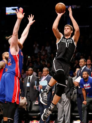 Pistons center Aron Baynes defends as Nets center Brook Lopez sinks a buzzer-beating jumper to beat the Pistons, 98-96, on March 21, 2017 in Brooklyn.