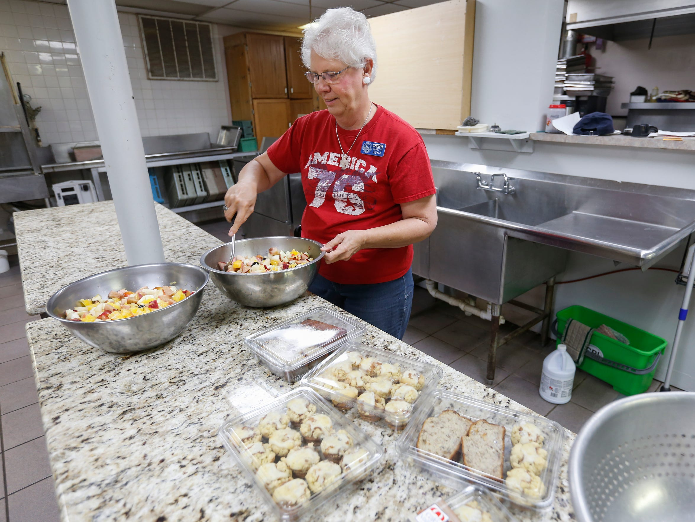 Cheryl Curtis volunteers in the kitchen at the Lives