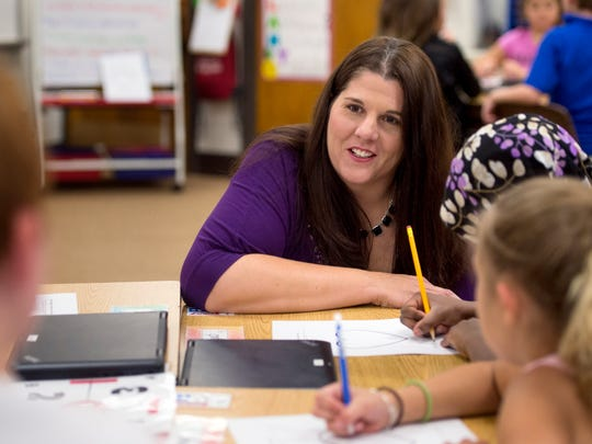 Jennifer Payne speaks with students in her classroom during a brainstorming activity at Daniel Wertz Elementary School in Evansville, Ind., on Thursday, Aug. 31, 2017.