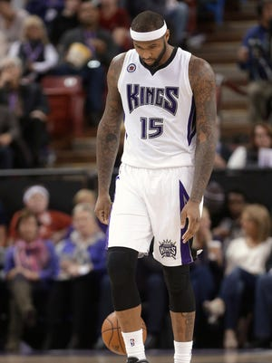 Sacramento Kings center DeMarcus Cousins walks down the court after the Kings turned the ball over to the Miami Heat in the closing moments of an NBA basketball game in Sacramento, Calif., Friday, Jan. 16, 2015. The Heat won 95-83. (AP Photo/Rich Pedroncelli)