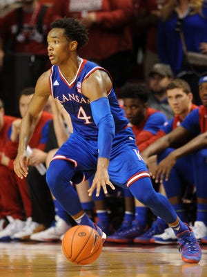 Kansas Jayhawks guard Devonte' Graham (4) drives to the basket against the Oklahoma Sooners during the second half at Lloyd Noble Center.