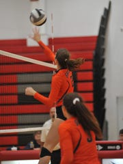 Galion's Marisa Gwinner strikes at the net against New Riegel.