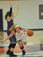 Gracie Groves dribbles past a Mt. Gilead player.