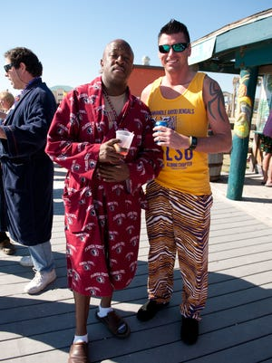The Krewe of Nauga celebrates the Mardi Gras season at the 18th annual Champagne Pajama Breakfast and Native Noontime Ball at The Dock on Pensacola Beach. Changes to the open container laws could prohibit consumption of alcohol on the Pensacola boardwalk.