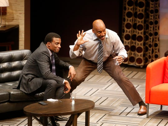 """Lewis (left, Garrett Lee Hendricks) and Frank (Ezra Knight) square off in """"Playing the Assassin"""" at the Delaware Theatre Company."""