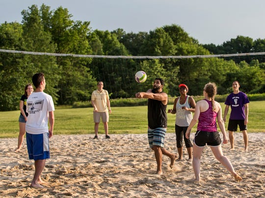 Mahesh Derangula sets the ball for a teammate on Tuesday evening during a pick-up volleyball gam at Bellevue State Park.