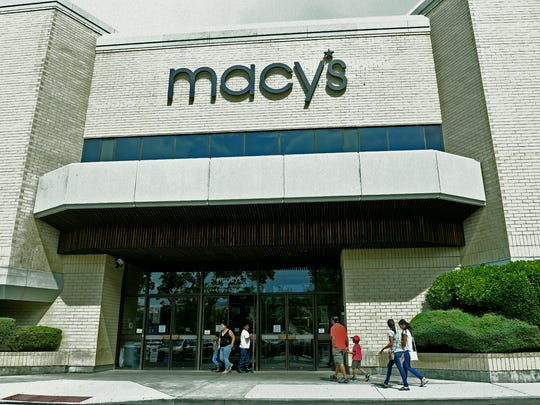 Shoppers visit Macy's at Meadowood Mall on Aug. 22, 2016