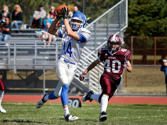 Horseheads' Andrew Clark catches a touchdown pass against Johnson City on Sept. 24.