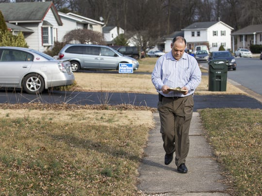 Republican senate candidate John Marino canvasses a neighborhood near Newark.