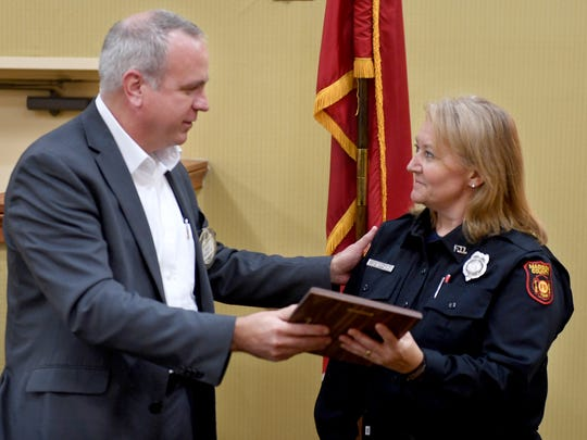 Jackson Exchange Club President Kirk Newcom presents Madison County Fire Department fire fighter Kay Long with the Fire fighter of the Year Award, Tuesday, October 10.