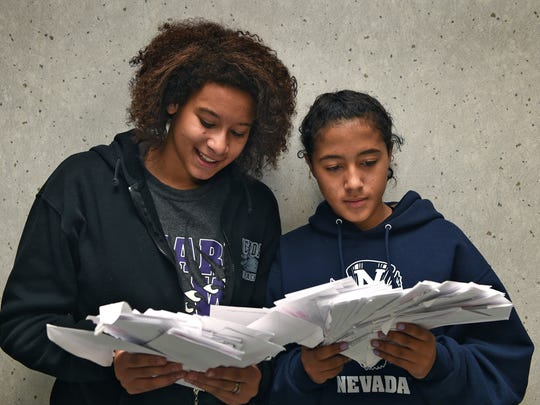 Taylissa Marriott, left, and Jayla Tolliver hold the letters of support they have received from Swope Middle School students who have read the RGJ story of them being bullied at their high school. Both attend Yerington High School where they say they have been racially harassed.
